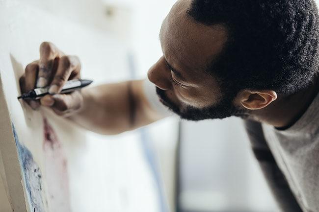 Artistic man paints